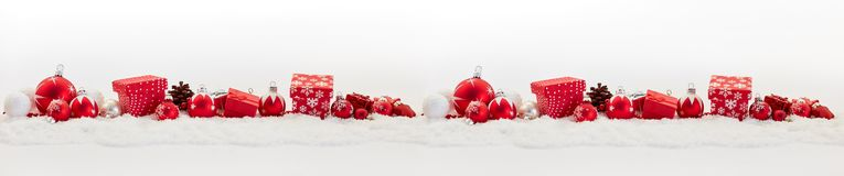Background for christmas banner. With many presents and baubles Royalty Free Stock Image