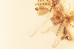 Background for Christmas card with golden toys and glass icicle stock images