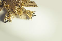 Background for Christmas card with golden toys and glass icicle royalty free stock photography