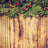 Background for Christmas Card. Xmas Evergreen Border on Wooden Stock Image