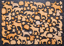 Background with Christmas cookies gingerbread. Gingerbread in the shape of animals, stars and hearts. Royalty Free Stock Images