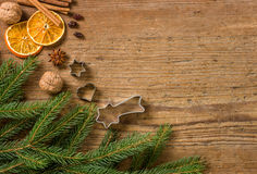 Background with Christmas decorations and cookie cutters Royalty Free Stock Image