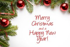 Background with Christmas decorations with greeting `Merry Christmas and a Happy New Year!` Stock Photos