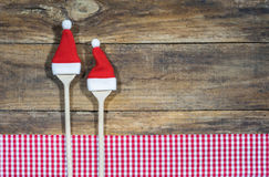 Background for Christmas Food Cooking Recipe. Christmas background with wooden spoon and Santa hats for Christmas food, recipe, cooking or menu card royalty free stock photography