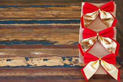 Background: christmas gifts  package with red golden bow Stock Photo