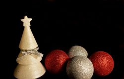 Christmas greeting card. Christmas decorations, balls and candle tree. royalty free stock photography