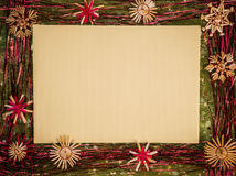 Background for Christmas greeting card- holiday straw decoration, green color textured fabric. Background for Christmas greeting card. Composition of christmas Stock Images