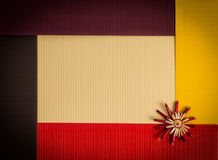 Background for Christmas greeting card- holiday straw decoration, red and yellow color textured paper Stock Photography