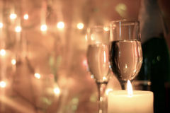 Background for Christmas greetings. New Years and Christmas Eve celebration background with an elegant arrangement with flutes and bottle of champagne and Stock Images