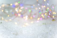 Background for Christmas, with snow and lights Stock Photography