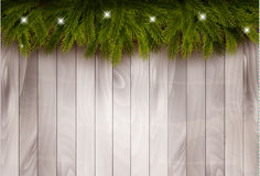 Background with christmas tree branches and baubles in front of a wooden wall. Royalty Free Stock Photo