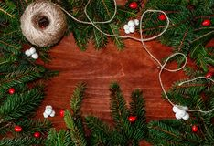Background with Christmas tree branches, berries and string of t Royalty Free Stock Images