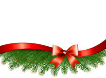 Background with christmas tree branches and a red ribbon. Stock Photo