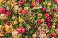 Background of Christmas tree ornament lights with glitter decoration balls in foreground.  stock photography