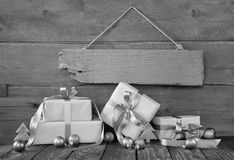 Background: Christmas voucher or coupon with presents in grey an Stock Photos