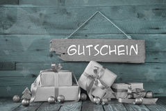 Background: Christmas voucher with presents in silver and mint g Royalty Free Stock Photos