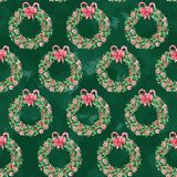 Watercolor seamless pattern with Christmas wreaths on dark green background stock image