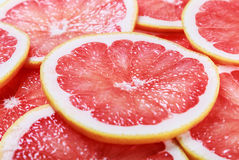 Background with citrus-fruit of grapefruit slices Royalty Free Stock Image