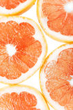 Background with citrus fruit of grapefruit slices. Studio photography Stock Photo