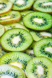 Background with citrus-fruit of Kiwi slices. Very shallow depth of field, focus in the center of the frame Stock Images