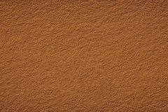 Background of clay court texture. Red clay court tennis background texture. Tennis court close-up of gravel surface Royalty Free Stock Photography