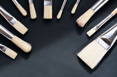 Background with  clean brushes with wooden handle on black table. Background with many clean brushes with wooden handle on black table Royalty Free Stock Photography