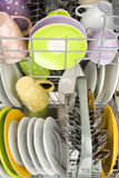 Background of clean dishes in dishwashing machine, front view Stock Images