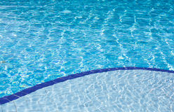 Clear blue water in swimming pool Royalty Free Stock Images