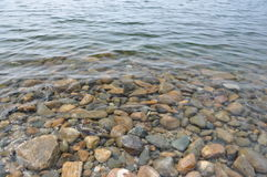 Clear water and rocks. Stock Photos
