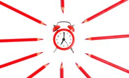 Background of clock on white sheet circled with pencil colors. School concept stock image