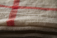 Background close up of a hessian scarf fabric folded Stock Photography
