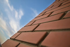 Background of close up urban red brick wall and sky with clouds Stock Photography