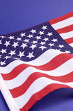 Background close up of USA Stars and Stripes flag - vertical Royalty Free Stock Photography