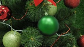 Background closeup of a Christmas tree decorated with red and green balls. Closeup royalty free stock photography