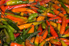 Background of closeup red and green hot peppers Stock Photo