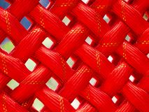 Background closeup of a red knitted carpet with Golden thread during a chinese celebration royalty free stock photo