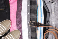 Background from clothes and a shoe. Pair of sports summer shoes and jeans and a belt Royalty Free Stock Photos