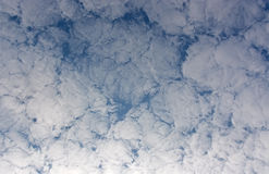 Background of clouds against blue sky. Royalty Free Stock Image
