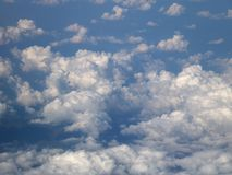 Background with clouds on blue sky, from the plane view stock photo