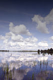 Background of cloudy sky reflection on lake Stock Image