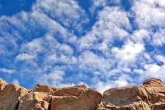 Cloudy sky. Background of cloudy sky and rock Royalty Free Stock Image