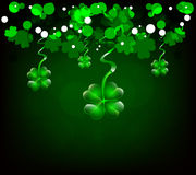 Background with clovers. Dark green background with clover shapes Royalty Free Stock Photography