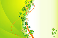 Background with clovers and gold horseshoes Stock Photos