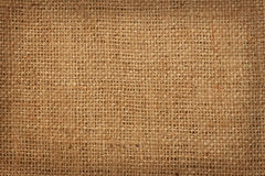 Background of coarse linen burlap. The background of coarse linen burlap in a cage Stock Photo