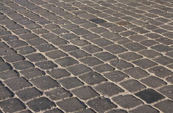 Background Cobblestones. A cobblestoned street background in light and shadow Stock Photography