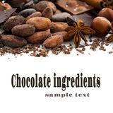 Background with cocoa beans, chocolate and spices, closeup Royalty Free Stock Image