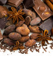 Background with cocoa beans, chocolate and spices, closeup Stock Images