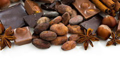 Background with cocoa beans, various chocolate and spices Royalty Free Stock Images