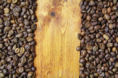 Background of coffee beans. And wood Stock Photo