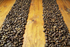 Background of coffee beans. And wood Royalty Free Stock Photography